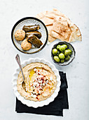 Artichoke Baba Ganoush with naan, falafel and stuffed vine leaves
