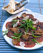 Flamed beef fillet with rocket, mushrooms and parmesan
