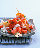 Melon salad with a scampi skewer