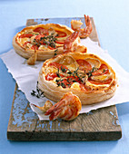 Tomato and cheese tarts and scampi