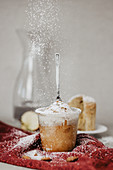 Christmas cake in a glass dusted with powdered sugar