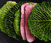 Roast beef and savoy cabbage leaves