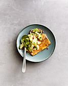 Fish fillet on a sugar loaf chicory salad