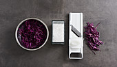 Red cabbage being grated