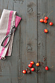 Cherries, chocolate and cherry stoneware on a gray wooden table
