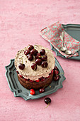Chocolate cake with brandy cherries and chocolate cream mousse