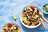 Mexican like pasta salad with vegetables and corn