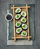 Maki sushi with mange tout
