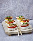 Nigiri sushi with mackerel and apple