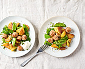 Fried potatoes and sausages with mange tout