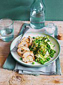 Stuffed chicken breast with zucchini and peas