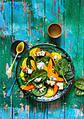 Spinach salad with pumpkin, yellow beet and blue cheese