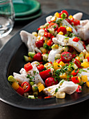 Carpaccio fish salad with cherry tomatoes and peppers