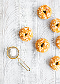 Croissant donuts with almond flakes