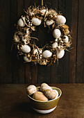 Easter wreath and bowl of Easter eggs