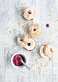 Croissant donuts filled with creamy cream and berry puree
