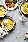 Rice with dal, potato curry and sesame fritters (India)