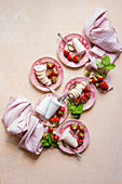 Strawberry Kulfi served on pink china plates , pink linen with fresh picked strawberries