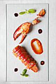 Lobster with sauce on a glass plate