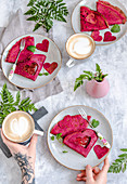 Valentine pink beetroot pancakes with jam, served with coffee