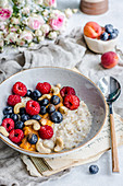 Porridge with summer fruit, blueberries, raspberries and cashews