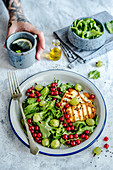 Salad with grilled halloumi, currants, gooseberry and black cumin