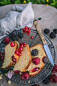 Summer cake with raspberries, blackberries and currants