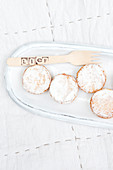 Muffins with powdered sugar on a serving platter
