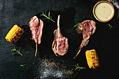 Grilled bbq rare rack of lamb with sweet corn cobs, rosemary and cheese sauce