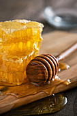 Honeycomb, honey spoon and honey