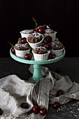 Plate with cupcakes and cherries