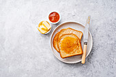 Morning toasts with butter and confiture
