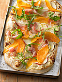 Pumpkin and onion pizza with apple and bacon