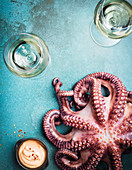 Wineglasses and raw octopus