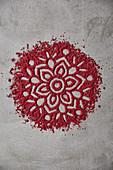 A mandala pattern made from strawberry powder