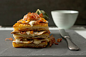 A mushroom millefeuille with bacon and vegetables