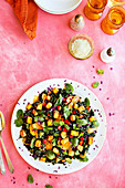 Fried potato salad with kale, carrots, mint and coriander