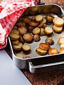 Roast potato in a baking tin