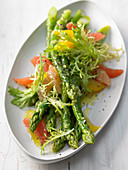 Frisee lettuce with asparagus and citrus fruit