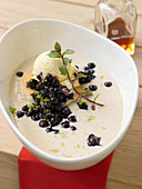 Semolina soup with blueberries and vanilla ice cream