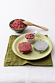 Minced meat, a pair of scales, a burger press and a raw burger