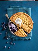 Warm blueberry and vanilla pie with vanilla ice cream