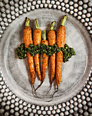 Oven-baked carrots with herb sauce