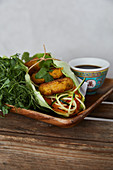 A hamburger with vegetables, herbs and soy sauce (Asia)