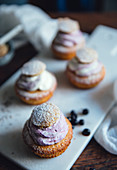 Cupcakes with blueberry cream