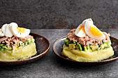 Peruvian layered salad with mashed potatoes, avocado, tuna and egg
