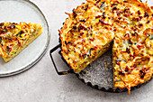 Potato fritter quiche with leek and bacon