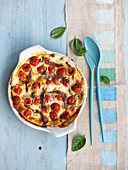 Spicy clafoutis with mozzarella, anchovies and basil