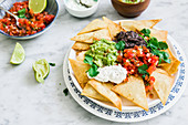 Mexican nachos with various toppings