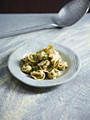 Stuffed Cappellacci with mint artichoke salad